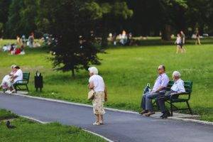 man and woman park bench