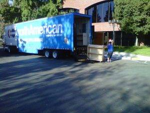 office furniture movers load moving truck